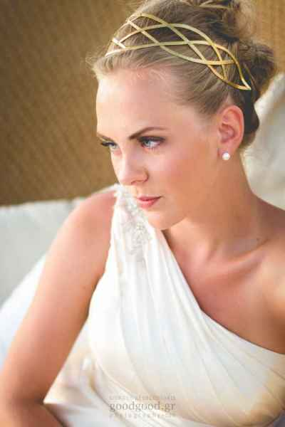 Photograph of a bride sitting on a daybed at Amirandes Grecotel at Heraklion Crete Greece