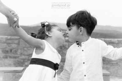 Black and white photo of boy and girl toddlers about to kiss mouth to mouth