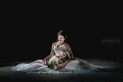 Bride sitting on the floor and holdin a bridesmaid in her hands