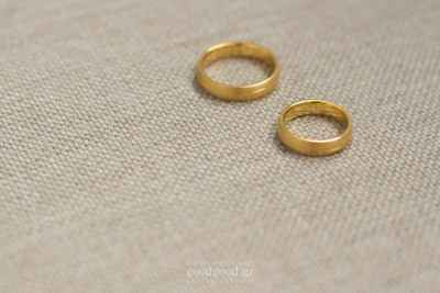 Photograph of two wedding rings placed on a fabric