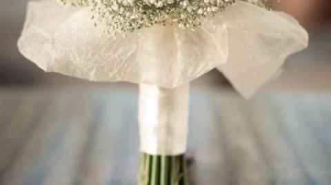 Photo of a wedding flower bouquet on a table