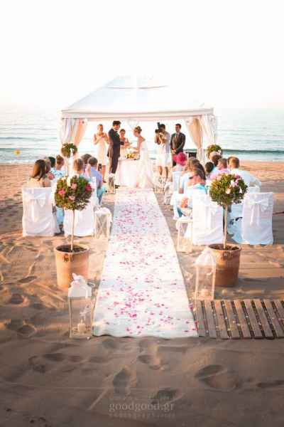 Photograph of a beach wedding under a tent at Anisaras Heraklion Crete
