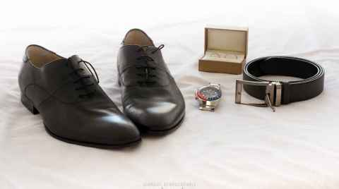 Photo of the grooms accessories, shoes, belt watch and rings