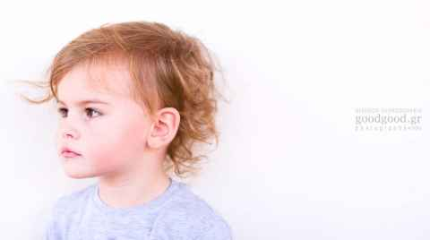Portrait of a three year old boy looking gazing away