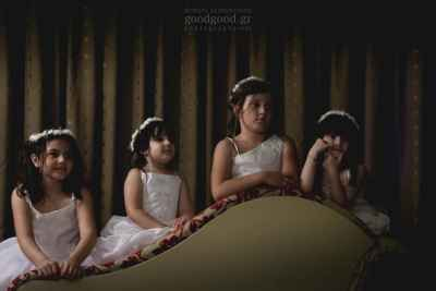 Photo of four little bridesmaids sitting reverse on a daybed