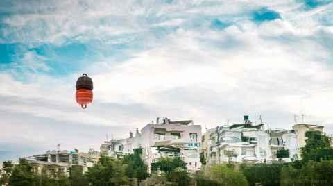 Photo of houses reflection on the water on the lake of Agios Nikolaos near a buoy
