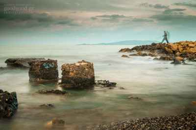 Photo of a standing man rock fishing in the calm sea at Karavola area in Heraklion