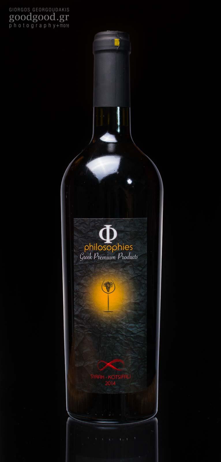 A Syrah-Kotsifali wine bottle, photographed in dark background