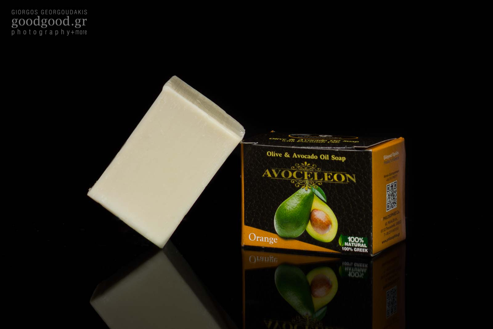 Product photograph of a bar of soap made of olive and avocado oil in dark background