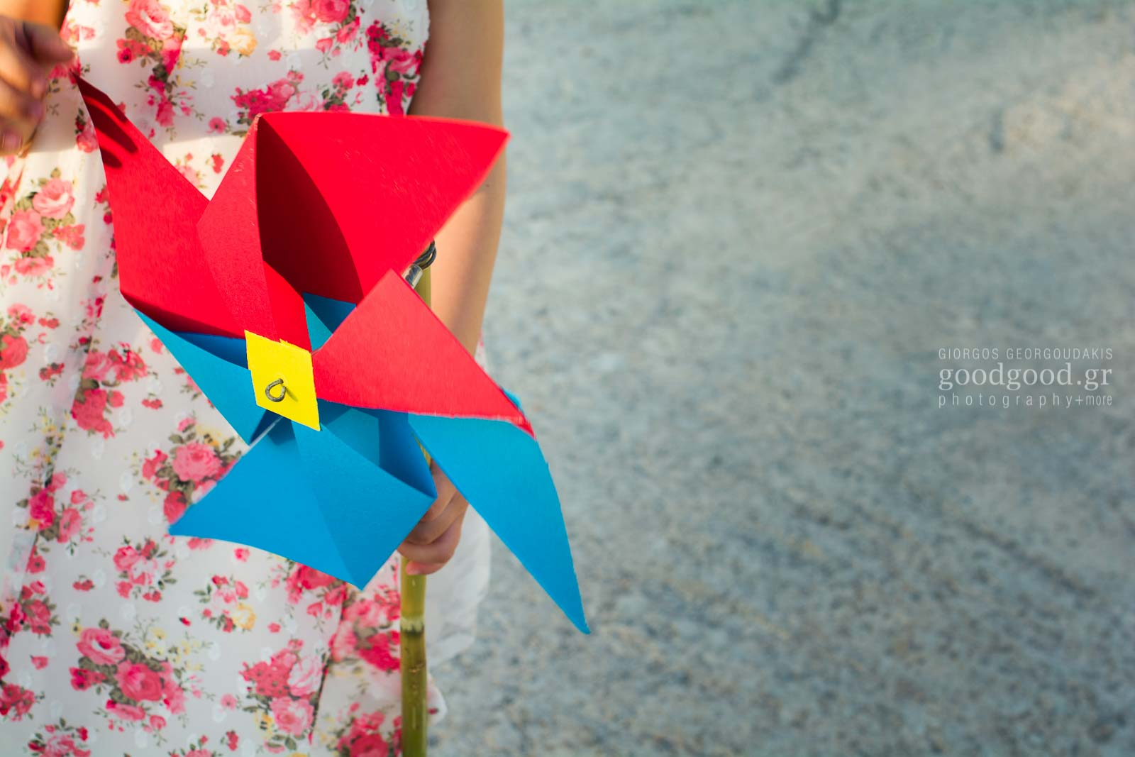 Girl holding a paper windmill