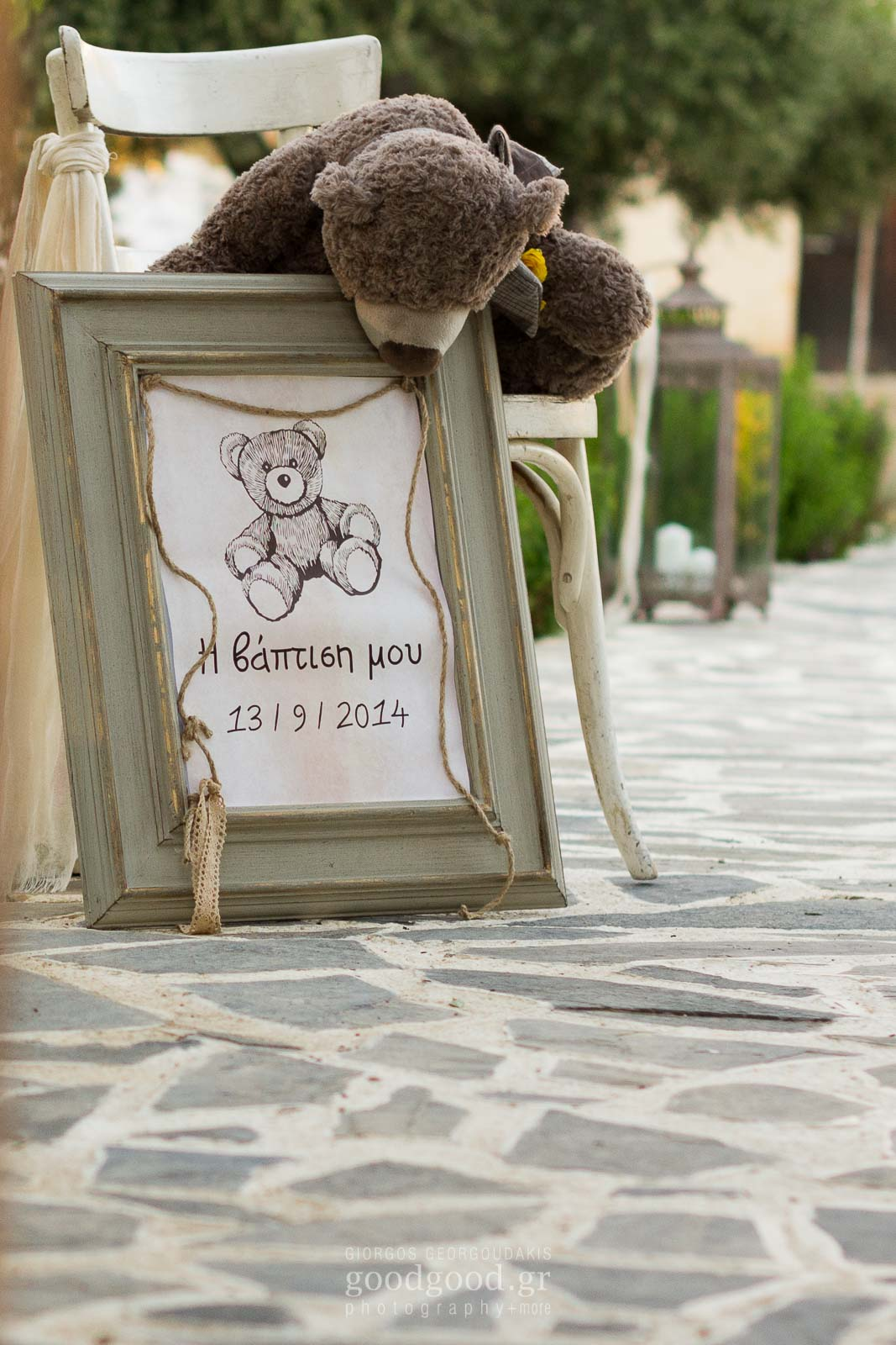 Teddy hanging on a baptism christening welcoming sign