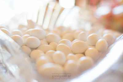 Wedding white sugared almonds inside a glass bowl