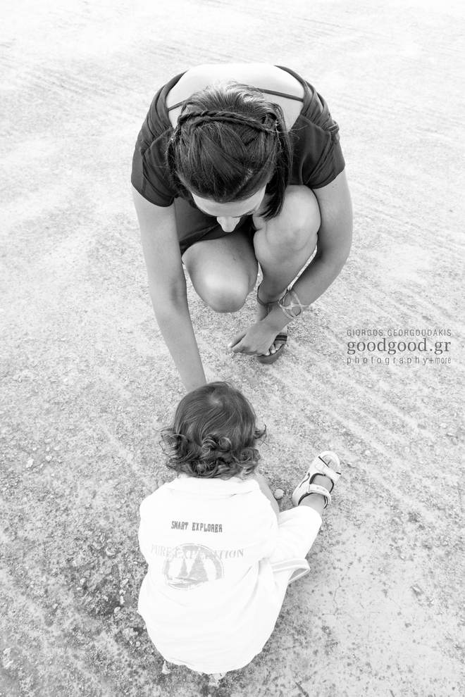 Godmother playing with her godchild on the floor