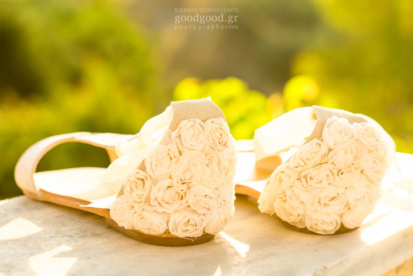 Girls christening shoes decorated with white roses