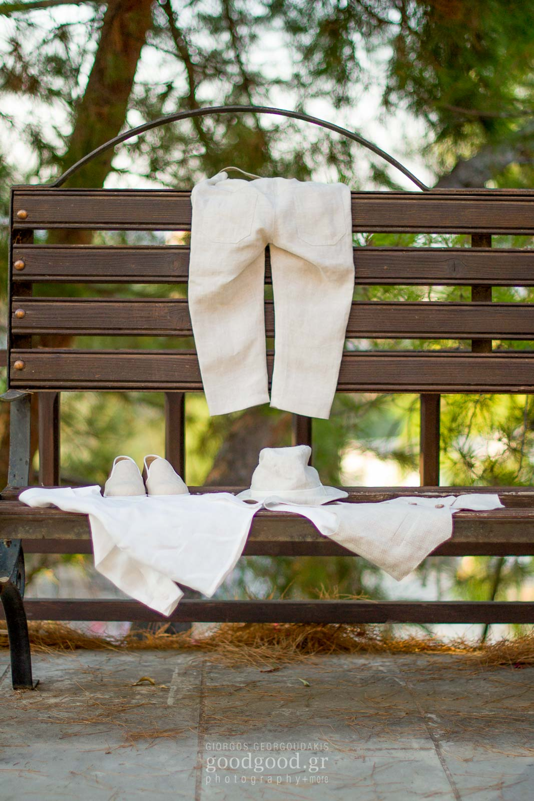 Baptism clothes hanging on a bench