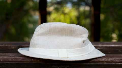 White hat on a wooden bench