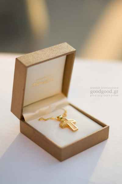 Golden christening cross inside a box