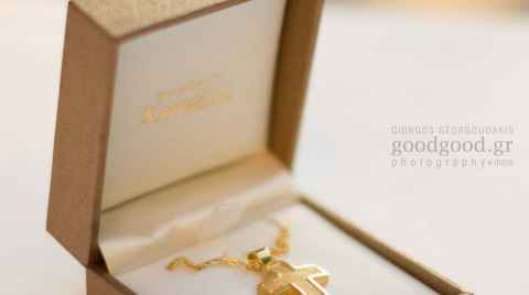 Golden christening cross inside a box