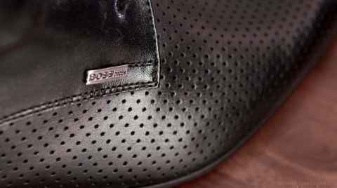 Close up photo of the BOSS plate on groom's shoes