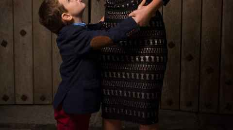 Mother and son blowing kisses