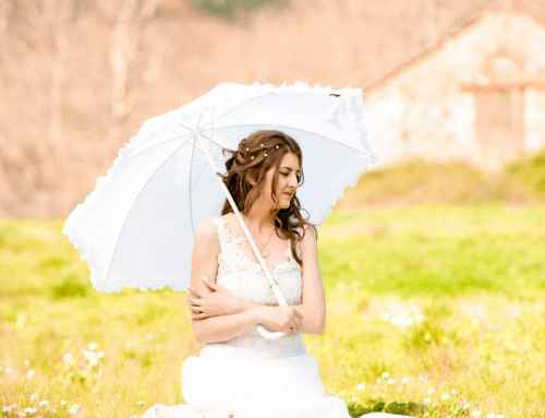 Bride On The Grass Holding An Umbrella